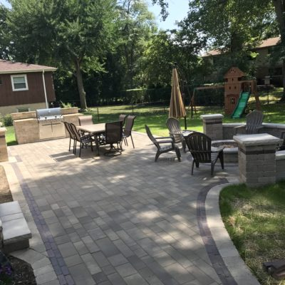 Landscaping Design Elmhurst: Custom Brick Patio with Fire Pit